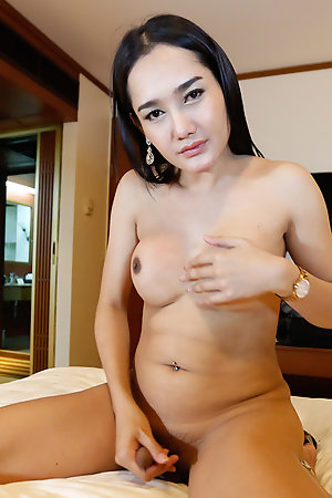 Beautiful Thai ladyboy takes white cock up her ass