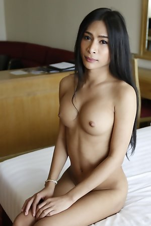 25yo busty Thai shemale sucks and fucks white cock and licks up his cum