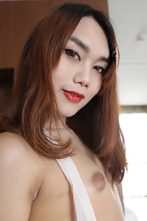 22 year old Thai ladyboy gets made up for her date and a facial from her tourist friend