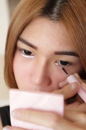 19 year old Thai ladyboy gets made up for her date and a facial from her tourist friend