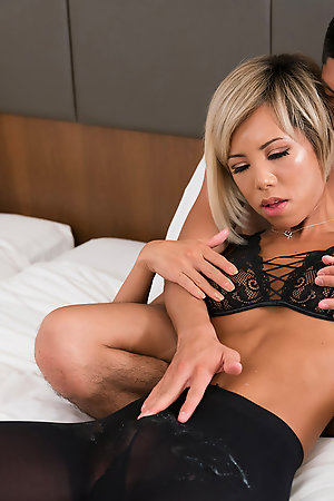 Japanese tgirl Miran gets a handjob while guys cover her cock with sperm.