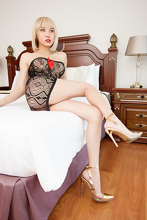 Alice is looking drop-dead gorgeous with short blonde hair, in a little black dress, and high heels.