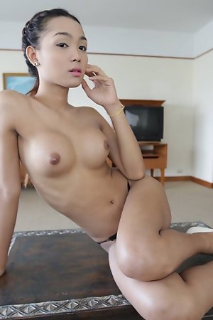 22 year old busty Thai ladyboy gets naked and poses for tourist