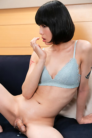 Yoko is stroking her clit hard while sucking this massive cock