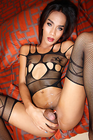 Ladyboy Game has a smoke outside before changing into a slutty black body stocking.