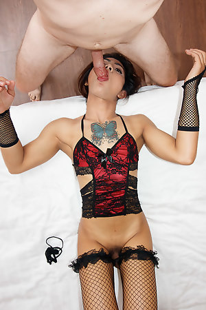 Manaw naturally sexy body is decorated in a lacey red and black blouse with sheer panties, black stockings and gloves.